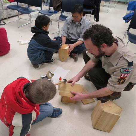 scouts and leaders assembling birdhouses